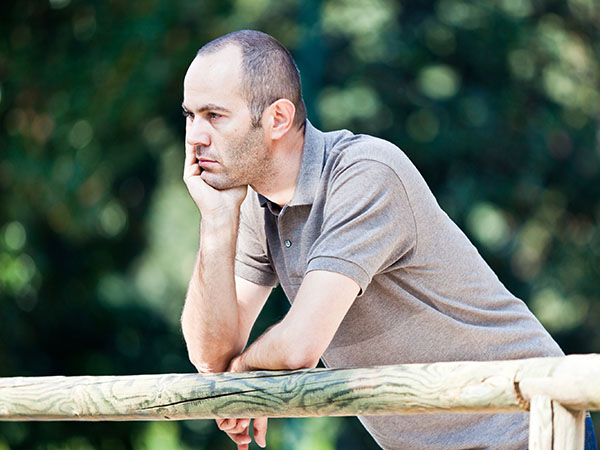 Pensive Adult Man at Park